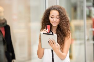 A girl paying by credit card for shopping